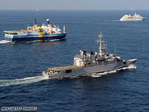 A Frech frigate, centered, escorts ships off the coast of Dijibouti to protect them from piracy last month.